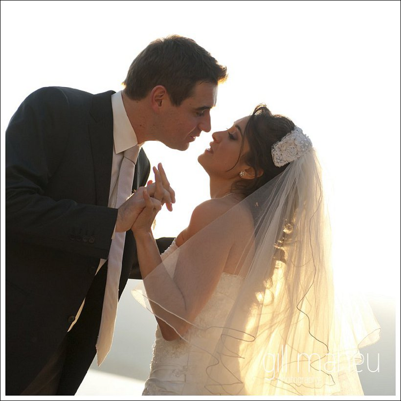 sunlit kiss from bridal couple photos