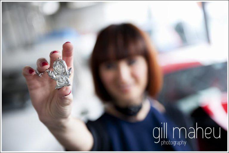 silver angle badge find at car breakers yard Geneva - young woman by wedding photographer Gill Maheu Photography