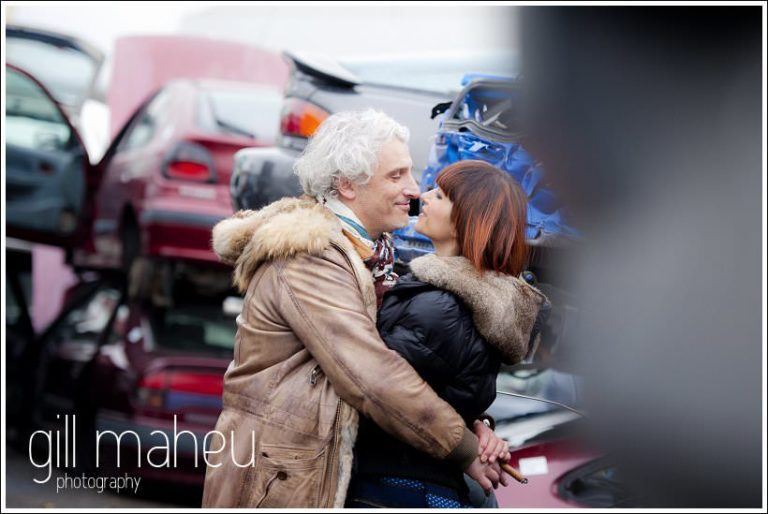 fabulous couple on ultra stylish engagement shoot in car breakers yard in Geneva by portrait and wedding photographer Gill Maheu