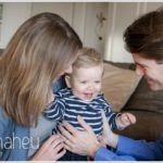 toddler being cuddled by parents by lifestyle photographer Gill Maheu