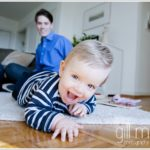 young toddler with gorgeous smile crawling towards the camera by lifestyle photographer Gill Maheu Photography