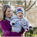 Mum and toddler with gorgeous woolly hat in the winter sunshine of park  by lifestyle photographer Gill Maheu