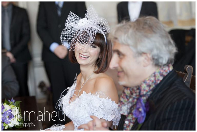 bride looking lovingly at groom during civil wedding ceremony at Mairie de Dardagny near Geneva by Gill Maheu Photography, photographe de mariage