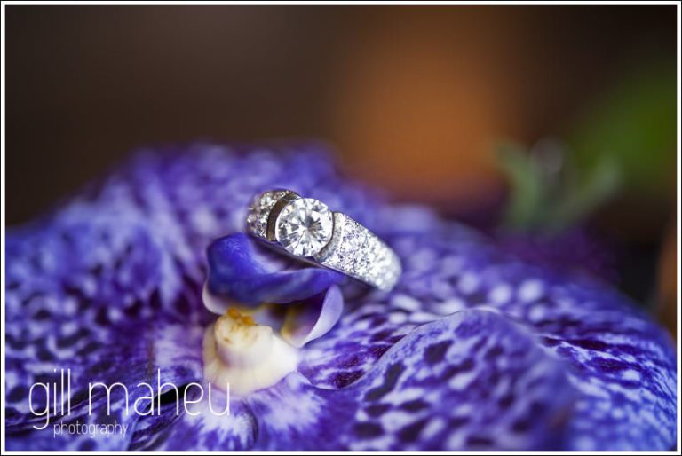 close up wedding details: stunning diamond ring on purple orchid by Gill Maheu Photography, photographe de mariage