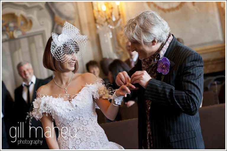 couple exchanging rings civil wedding ceremony at Mairie de Dardagny near Geneva by Gill Maheu Photography, photographe de mariage