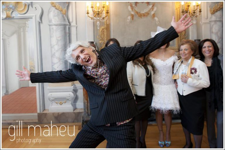 celebrating groom at Mairie de Dardagny, Suisse wedding by Gill Maheu Photography, photographe de mariage