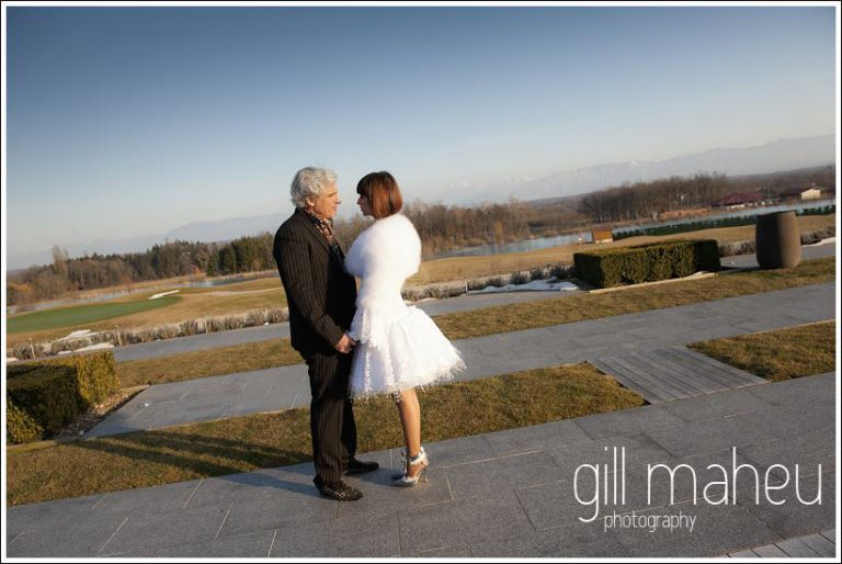 full legth wedding portrait of happy couple in spring sunshine at Jiva Hills Geneva by Gill Maheu Photography, photographe de mariage