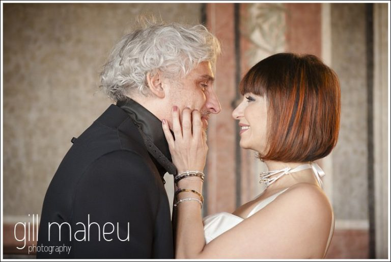 bride and groom first kiss at wedding ceremony at Chateau de Bagnols wedding by Gill Maheu Photography, photographe de mariage