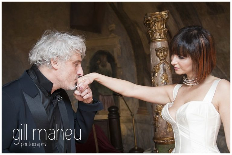 groom kissing bride's hand at Chateau de Bagnols wedding by Gill Maheu Photography, photographe de mariage