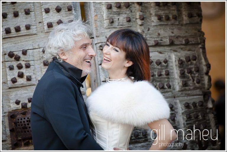close up bridal couple portrait in front of castle doors at Chateau de Bagnols wedding by Gill Maheu Photography, photographe de mariage