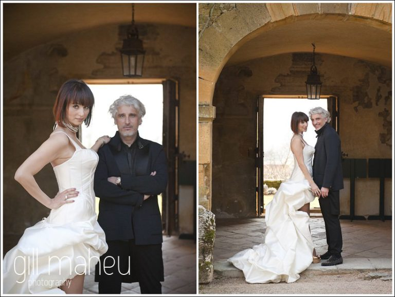 bride and groom photographed in ancient doorway at Chateau de Bagnols wedding by Gill Maheu Photography, photographe de mariage