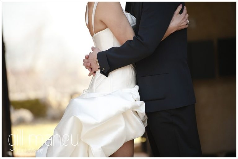 close up of bride and groom with arms around each other at Chateau de Bagnols wedding by Gill Maheu Photography, photographe de mariage