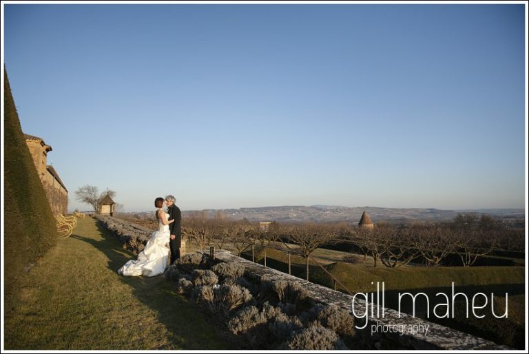wide landscape shot of wedding couple in Chateau de Bagnols wedding by Gill Maheu Photography, photographe de mariage