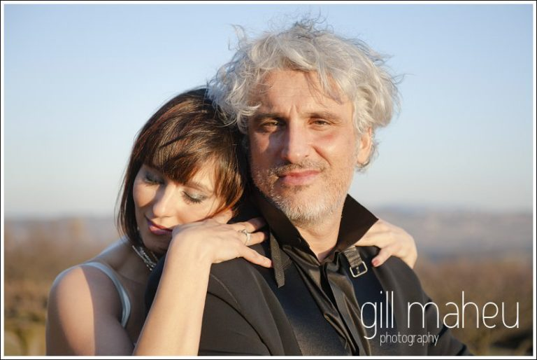 bride with head on groom's shoulder in sunset at Chateau de Bagnols wedding by Gill Maheu Photography, photographe de mariage