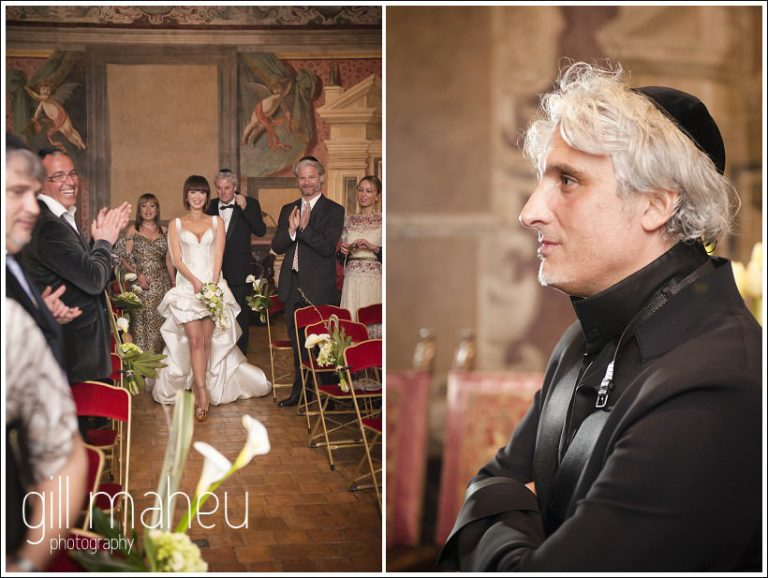groom watching bride coming down aisle at Chateau de Bagnols wedding by Gill Maheu Photography, photographe de mariage