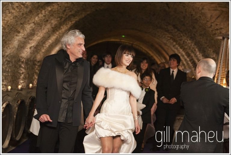 bride and groom enter evening celebrations at Chateau de Bagnols wedding by Gill Maheu Photography, photographe de mariage