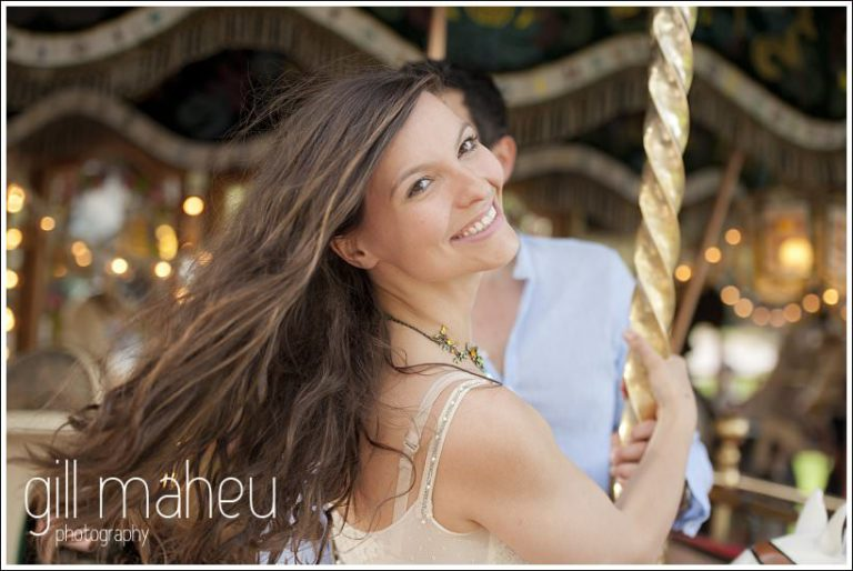 beautiful bride to be laughing on merry go round in Annecy by Gill Maheu Photography, photographe de mariage