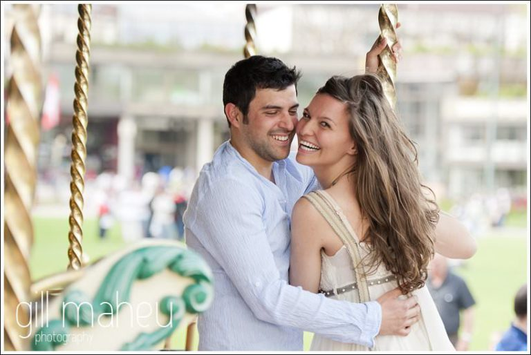 portraits of engagement couple kissing on merry go round in Annecy by Gill Maheu Photography, photographe de mariage