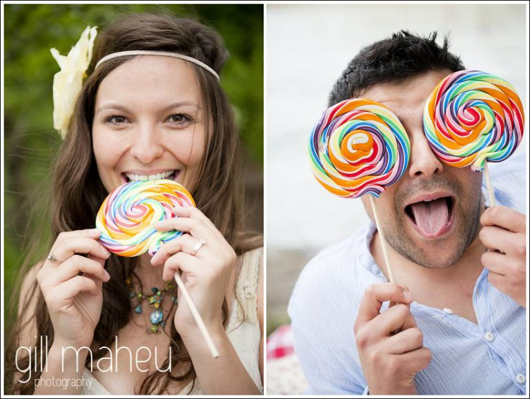 engagement session groom hiding face behind giant colourful lollipops by Gill Maheu Photography, photographe de mariage