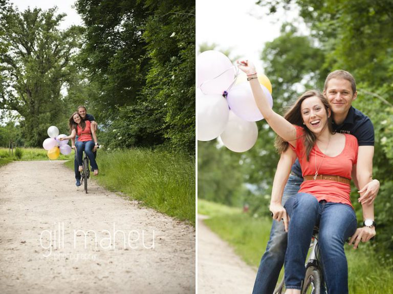 bride to be sitting on handlebars of bike ridden by groom engagement session Geneva by Gill Maheu Photography, photographe de mariage
