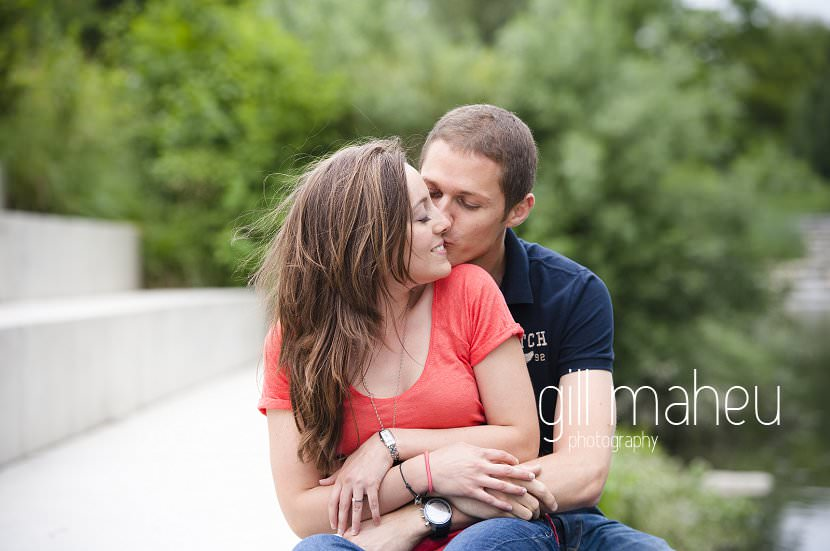 bride to be kissing groom engagement session Geneva by Gill Maheu Photography, photographe de mariage