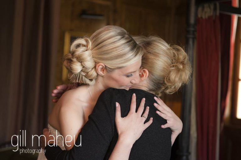 bride and mother hugging before leaving for wedding ceremony at Hotel Saint Pères above Chambéry by Gill Maheu Photography, photographe de mariage