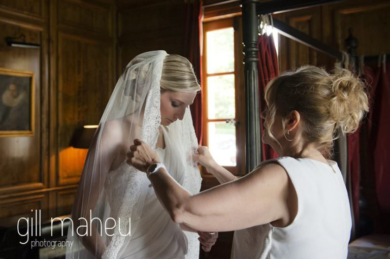mother arranging bride to be's wedding veil at Hotel Saint Pères by Gill Maheu Photography, photographe de mariage