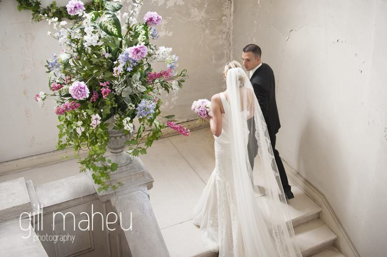 happy couple coming up stairs to civil wedding ceremony at Chateau Parc du Buisson Rond, Chambery, Hotel Saint Pères wedding by Gill Maheu Photography, photographe de mariage