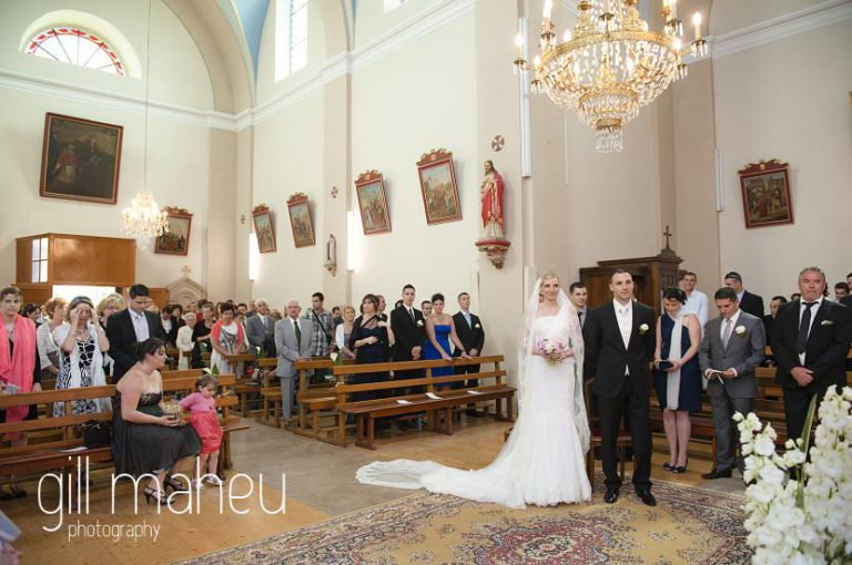 wide angle shot of bride and groom at church wedding ceremony,  Hotel Saint Pères wedding by Gill Maheu Photography, photographe de mariage