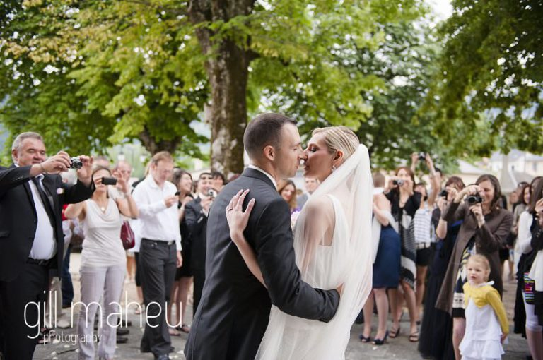 bride and groom kissing under confetti coming out of church,  Hotel Saint Pères wedding by Gill Maheu Photography, photographe de mariage