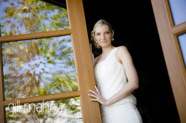 stunning bride at window of Hotel Saint Pères before leaving for ceremony, by Gill Maheu Photography, photographe de mariage