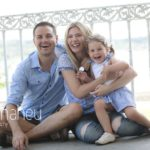 lifestyle portrait of parents with two toddlers in a park in Geneva Geneve by Gill Maheu Photography, photographe de famille