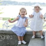 family lifestyle portrait of two toddlers in a park overlooking Lake Geneva Geneve by Gill Maheu Photography, photographe de famille