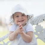 family lifestyle of portrait of young child being laughing at camera Geneve by Gill Maheu Photography, photographe de famille