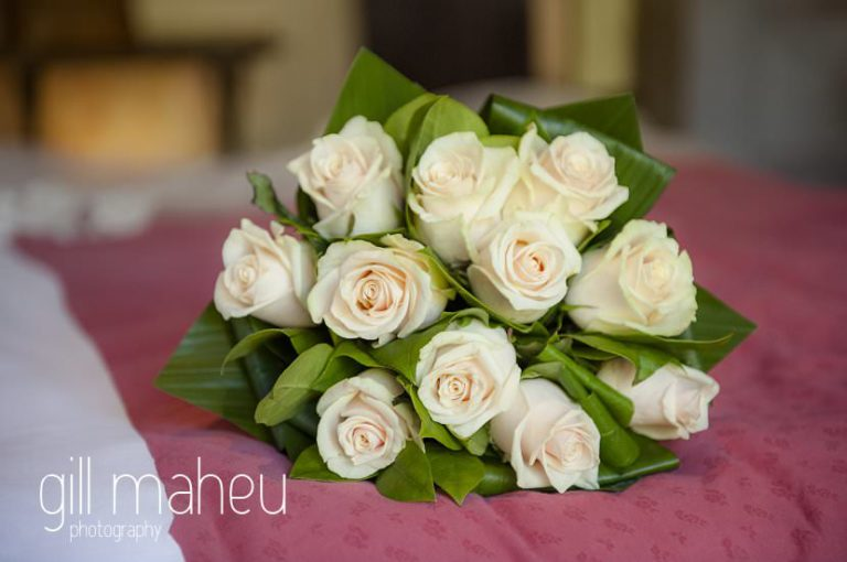 Wedding detail of beautiful white rose wedding bouquet at Chateau de Bagnols wedding by Gill Maheu Photography, photographe de mariage
