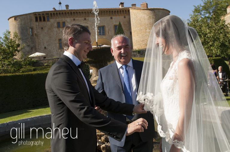 Father celebrating the wedding of his daughter and son in law in the gardens of the Chateau de Bagnols wedding by Gill Maheu Photography, photographe de mariage