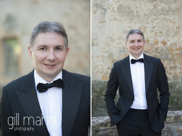 groom in front of old castle doors at Chateau de Bagnols wedding by Gill Maheu Photography, photographe de mariage