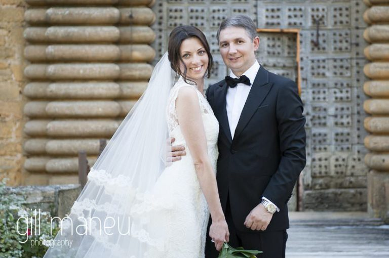 close up portrait of bride and groom in front of old castle doors at Chateau de Bagnols wedding by Gill Maheu Photography, photographe de mariage