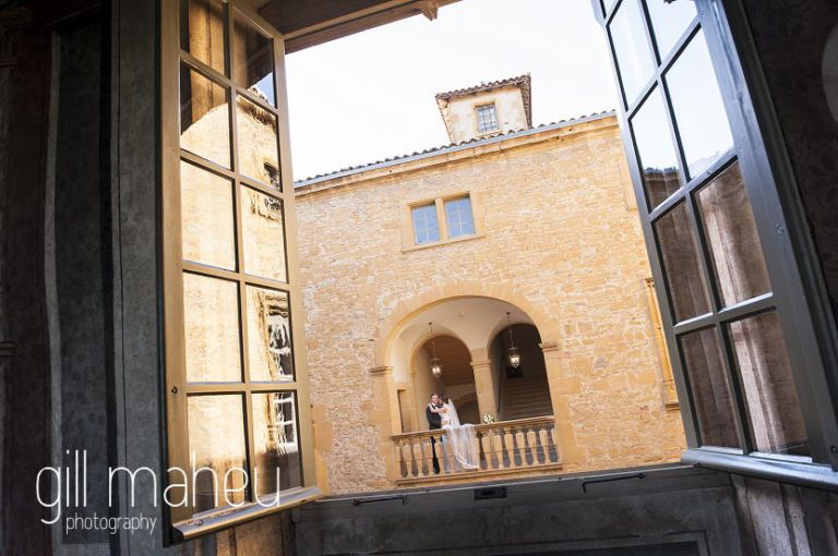 bride and groom in inner courtyard at Chateau de Bagnols wedding by Gill Maheu Photography, photographe de mariage