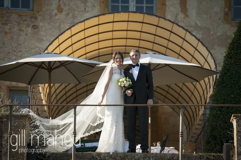 bride and groom on terrace at Chateau de Bagnols wedding by Gill Maheu Photography, photographe de mariage