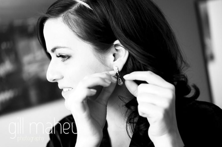 bridal portrait of bride putting in earring before La Bastille, Grenoble winter wedding by Gill Maheu Photography, photographe de mariage