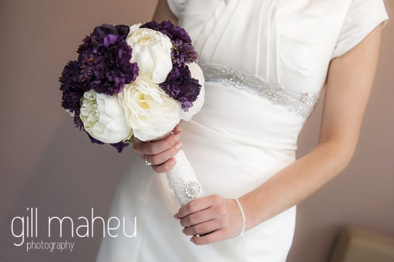 wedding detail of bride holding purple white bouquet before La Bastille, Grenoble winter wedding by Gill Maheu Photography, photographe de mariage