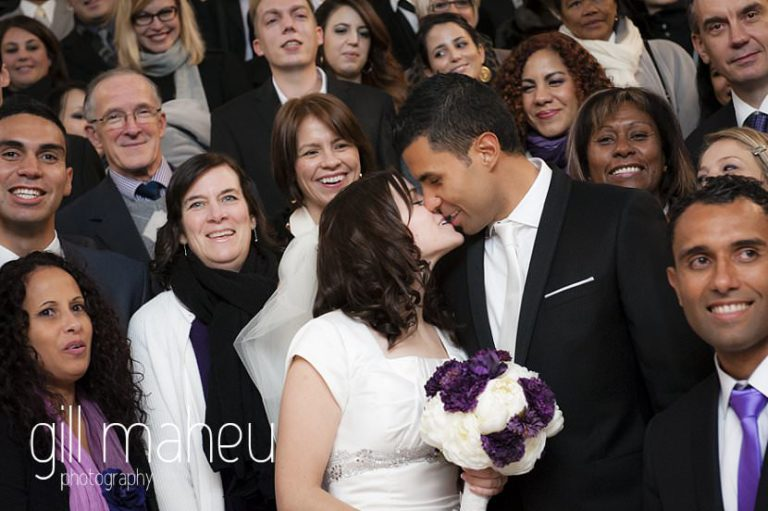 first kiss in front of guests at civil wedding ceremony at mairie de Grenoble at La Bastille, Grenoble winter wedding by Gill Maheu Photography, photographe de mariage