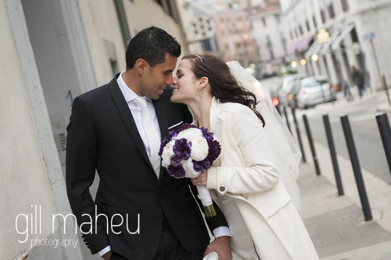 bride and groom kissing outside mairie de Grenoble at La Bastille, Grenoble winter wedding by Gill Maheu Photography, photographe de mariage