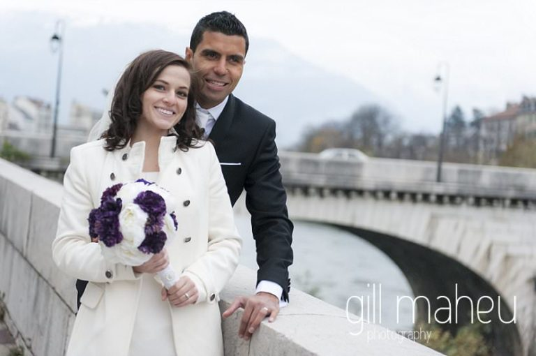 bride and groom in front of rivier Isère at La Bastille, Grenoble winter wedding by Gill Maheu Photography, photographe de mariage