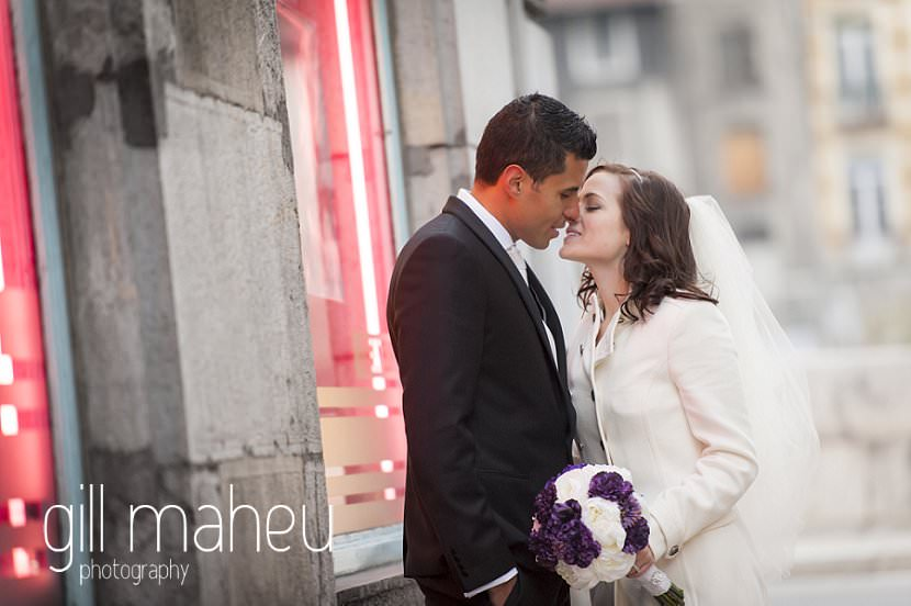 romantic couple kissing in streets in La Bastille, Grenoble winter wedding by Gill Maheu Photography, photographe de mariage