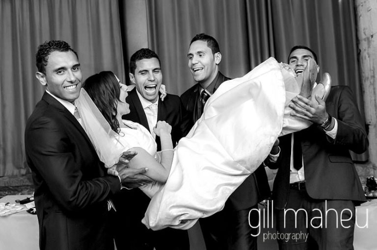 beautiful bride being carried by groomsmen at La Bastille, Grenoble winter wedding by Gill Maheu Photography, photographe de mariage