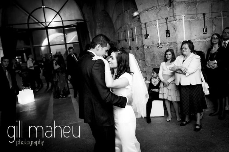black and white photo bride and groom first dance at La Bastille, Grenoble winter wedding by Gill Maheu Photography, photographe de mariage