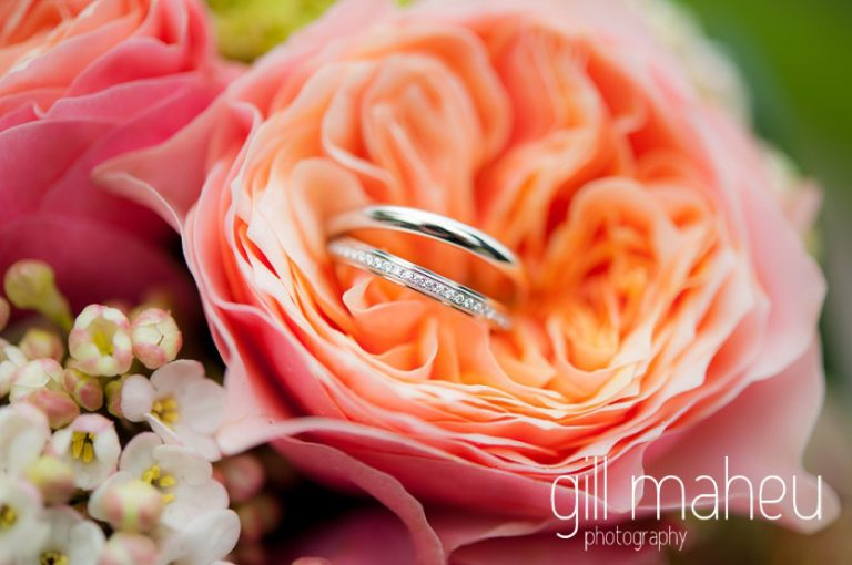 close up wedding details Cartier rings and bride's rose bouquet in park gardens after civil ceremony at Mairie Parc des Eaux Vives, Geneve by Gill Maheu Photography, photographe de mariage