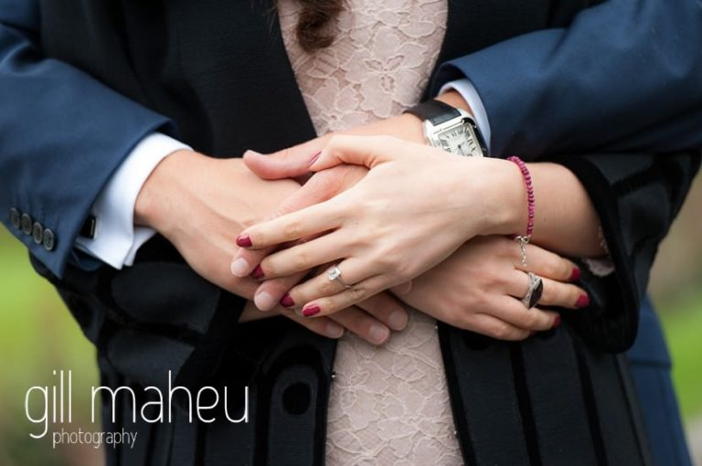 close up of bride and groom hands in park gardens after civil ceremony at Mairie Parc des Eaux Vives, Geneve by Gill Maheu Photography, photographe de mariage
